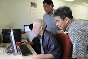 Darin Fernandez, left, works on a computer program and gets instruction from teaching and learning center instructor, Nelson Fading, center, as Mark Conching immediate past president of the Ohana Komputer board, looks on. Ohana Komputer partnered with Lanakila Pacific Day Program to provide computer-training services to adults who are developmentally challenged.