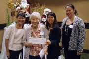 """The Moiliili Community Center was awarded a $10,000 grant from the Harry and Jeanette Weinberg Foundation at the foundation's """"Christmas in May 2013"""" award luncheon on May 30 at the Sheraton Waikiki Hotel. From left: Linda Day, Florence Kinoshita, Nadine Nishioka, and Kara Yamada."""