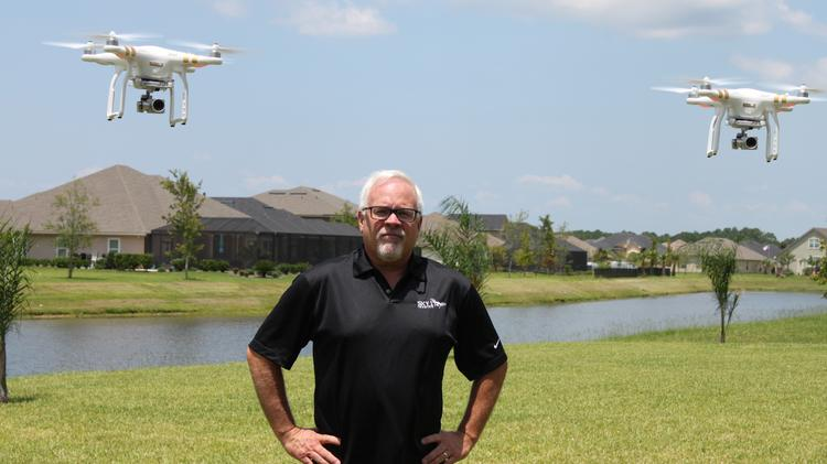 Tom Kane, pictured with his two DJI Phantom 3 professional-grade aerial drones in St. Augustine.