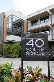Kristin Nakagawa, associate at Geoffrey Lewis Architect Inc., favors 40 S. School St., a commercial low-rise in Honolulu.
