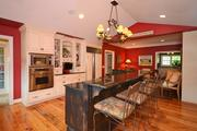 The home's gourmet kitchen has plenty of space for entertaining.
