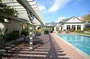In addition to the home, the property includes this pool, as well as a pond, tennis court and sports fields.
