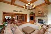 The family room has high ceilings and a stone fireplace.