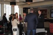Guests mingle during the Fast 50 pre-reception.