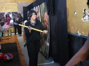 Mayor Stephanie Rawlings-Blake takes a sledgehammer to a former a DJ booth to help make way for Chesapeake Shakespeare's new downtown digs.