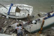 People salvage their boats on Singer Island after Hurricane Frances.