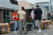 People sell generators on the side of the road after Hurricane Wilma.