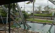 A screen enclosure surrounding a pool collapses after Hurricane Wilma.