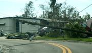 Downed powerlines block a street in Margate after Hurricane Wilma.