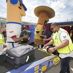 Southwest passengers surprised by Milwaukee Brewers players, Racing Sausages: Slideshow