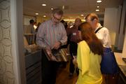 Lynn Hopffgarten of Bethesda Systems discusses automation systems with guests at the Case Design celebration.