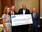 The Arthur W. Perdue Foundation presented the Cal Ripken Sr. Foundation with a $25,000 grant that will be used to bring the Badges for Baseball initiative to at-risk youth in Salisbury, Md. From left, Jan Perdue, Perdue Farms Chairman Jim Perdue, Cal Ripken Jr. and Jay Baker, chairman of the Ripken foundation's board of directors.
