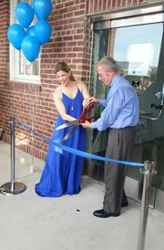 The Metropolitan Fine Arts Center of Alexandria has moved into the Workhouse Arts Center in Lorton. The new studio has 7,000 square feet. Melissa Dobbs, founder and president of the center, and John Mason, president and CEO of the Lorton Arts Foundation, handle the ribbon-cutting duties.