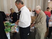Long & Foster CEO P. Wesley Foster, right, helped create a weekend food kit for You Feed Others.