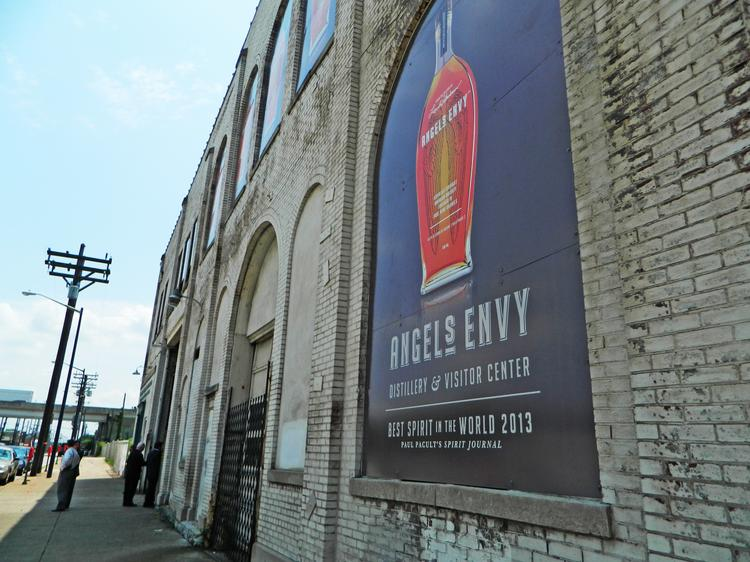 Angel's Envy signs are already up on the outside of a former Vermont American building in downtown Louisville.