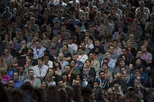 Attendees listen to Elon Musk, chief executive officer of Tesla Motors Inc. and Space Exploration Technologies Inc., not pictured, speaking during an interview at the South by Southwest Interactive Festival (SXSW) in Austin, Texas, on Saturday.