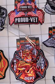 Biker patches for the armed forces and firefighters line a wall at the Hot Leathers biker shop on Main Street.