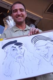 Caricature artist Justin Grosso was enjoying some business on his first visit to Bike Week.