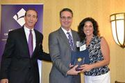 From left, Mark Ingrao of the Greater Reston Chamber of Commerce, C. Michael Ferraro of Training Solutions and Angela Inzerillo of AdviCoach.