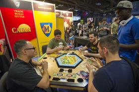 Attendees play Catan, a board game made by Mafair Games.com, at the South By Southwest Conference in Austin, Texas, U.S., on Sunday, March 10, 2013.