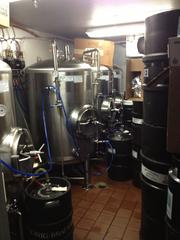 A refrigerated area allows for Cask & Larder to send house-made brews directly to taps on site.