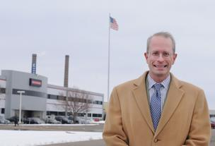 Developer Paul Hyde in front of the BAE building in Fridley