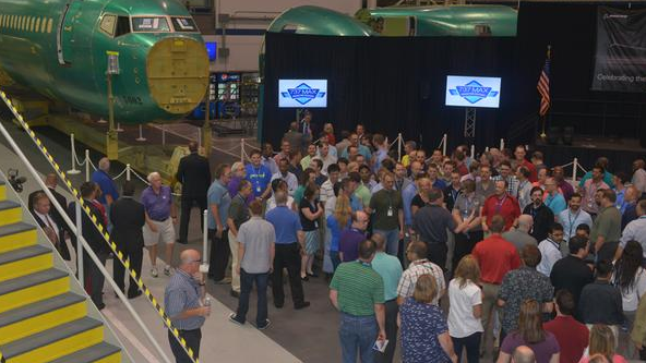 Employees at Spirit Aerosystems gather to celebrate the first 737 Max fuselage.