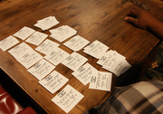 A bettor spreads out his wager stubs for the day's races.
