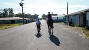 Jockey Maryjo Terleski walks with trainer Linda Norchan after an early morning workout.