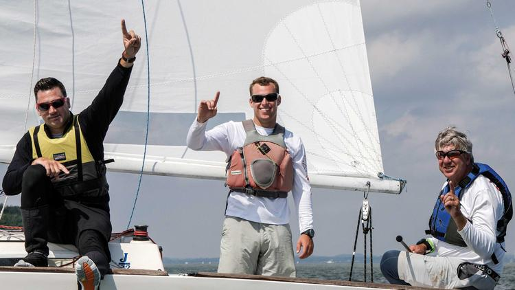 Crewmates Christopher Stressing, left, and Philip Wehrheim celebrate with Chris Doyle, far right, after racing to a world championship last month in Germany.