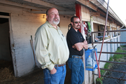Chris Sutton (right) - pictured here by the backside stables at Portland Meadows with father Ron - followed his dad's passion for horses and is now an owner and trainer.