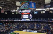 """Within the main arena of the Greensboro Coliseum there is now a larger central scoreboard system suspended with high-definition LED video screens, and a new larger """"ribbon"""" display ringing the upper level."""