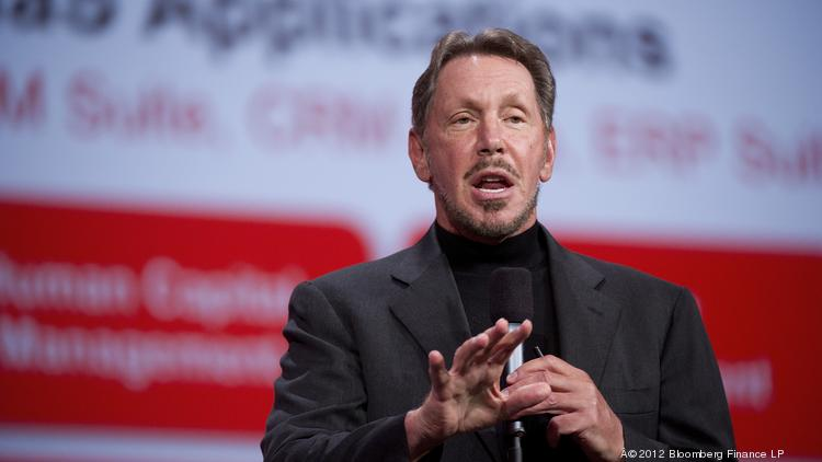 Oracle has sliced in half the stock-option grants it awards CEO Larry Ellison nearly one year after shareholders caused an uproar over his compensation.