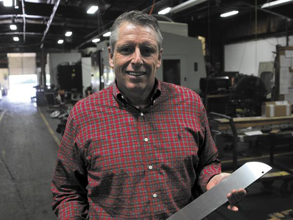 Cutting Edge: Chuck Biehn is CEO of CB Manufacturing, which posted more than $25 million in revenue last year, up 15 percent from the prior year. Biehn is holding a knife used by a food processor to cut chicken.