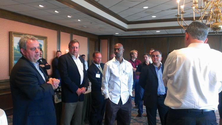 Corvalent Corp. CEO Ed Trevis (left) talks to peers at last year's YTexas meeting in Austin. Also pictured is former San Antonio Spurs basketball player TJ Ford (center).
