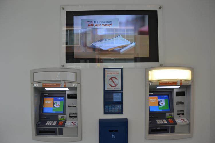 The new PNC Bank 'smart' ATMs allow customers to make deposits, cash checks and complete other transactions.
