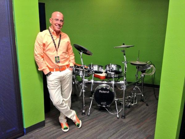 GoDaddy CEO Blake Irving poses next to his drum set in his Scottsdale office. He used to play drums professionally in his late teens and early 20s for touring bands and musicians.
