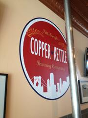Copper Kettle Brewing Company brand painted on the wall.