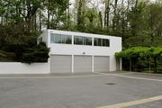 The new garage was built in place of the greenhouse in 1989.