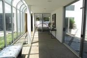 The original outdoor walkway between the main living area and the new family room was enclosed with glass in 1989.