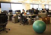 Employees work together in SurveyMonkey's open offices.