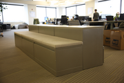 Storage cabinets double as seating at SurveyMonkey's Portland offices.