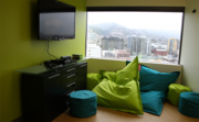 An employee break area at SurveyMonkey's U.S. Bancorp Tower offices offers sweeping views of the city.