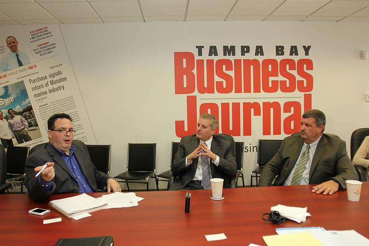 Editor of TBBJ Alexis Muellner speaks with the group in the TBBJ conference room.