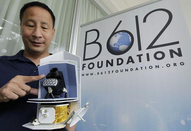 Ed Lu, chairman and CEO of the B612 Foundation, shows a model of the Sentinel Space Telescope.  Click above to see what his space telescope would look like.