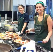Ryan LLC employees cook at the Ronald McDonald house.
