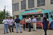 Jones Lang LaSalle employees take advantage of the growing food truck presence in Dallas at the annual spring fling.