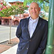 Rene Garcia of East Commerce Realty LLC believes the best is yet to come for Sunset Station (background).