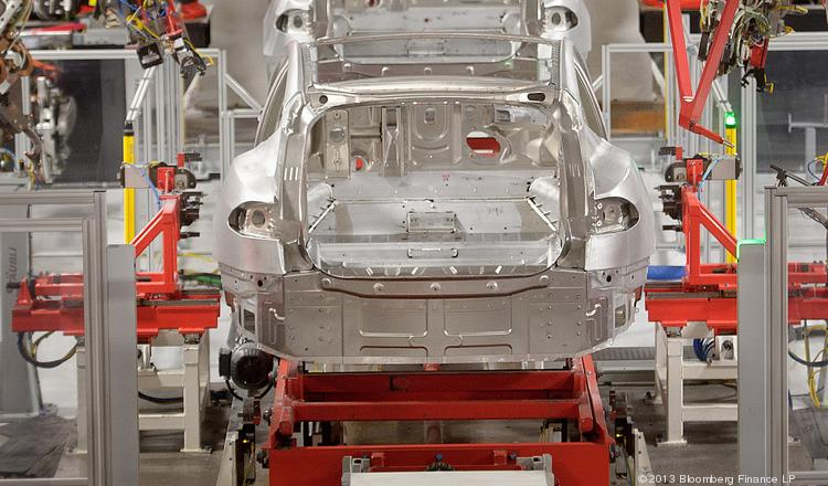 Telsa Motor Inc. Model S sedans make their way along a robotic assembly line at the company's assembly plant in Fremont, California.