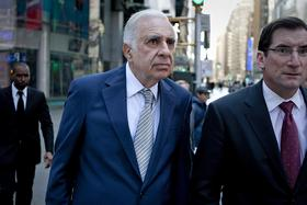 Carl Icahn, billionaire investor and chairman of Icahn Enterprises Holdings LP, left, walks outside of the Nasdaq MarketSite with Robert Greifeld, chief executive officer and president of Nasdaq OMX Group Inc.